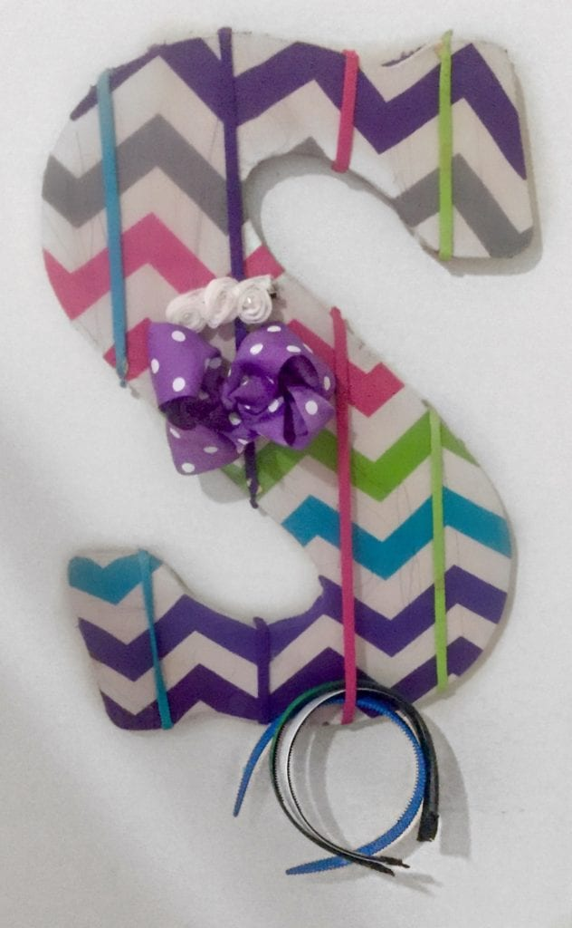 Homemade gift ideas like this initial bow organizer will be loved for years!