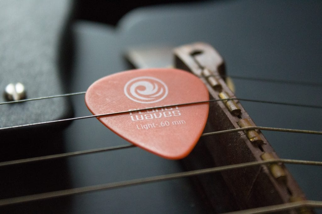 Choose great stocking stuffers for men that match their hobbies like guitar picks, tools, and cord clips!